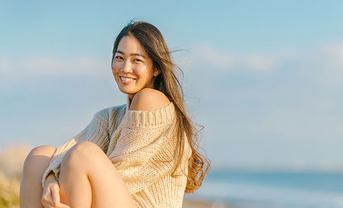 Young lady smile at the beach