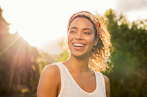 woman smiling in a sunny day outdoors
